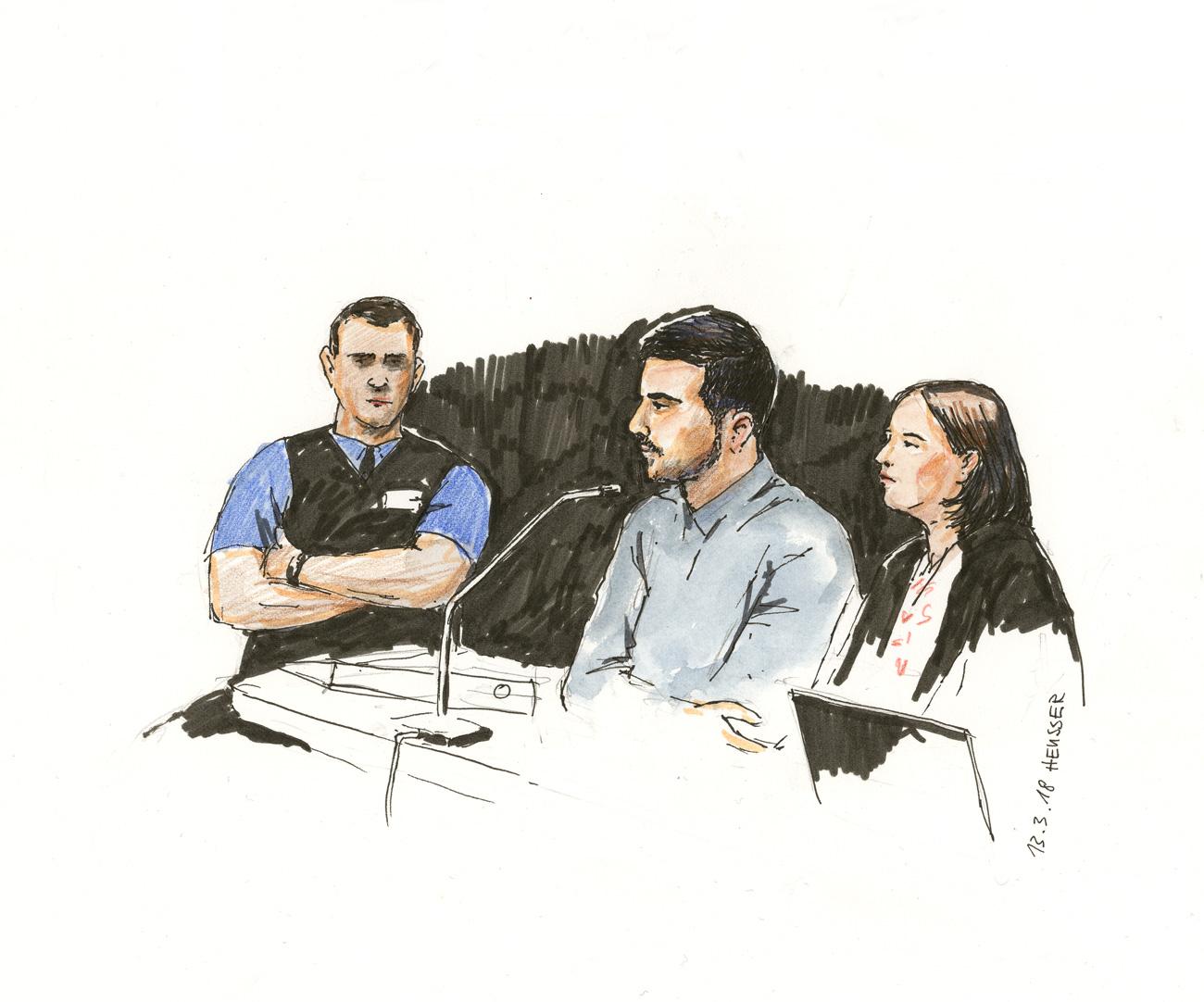 Der Angeklagte, die Verteidigerin und ein Beamter.